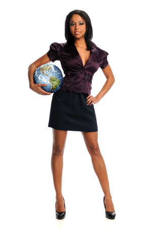 beautiful african American businesswoman holding planet earth standing isolated over white background Stock Photo - 15261446