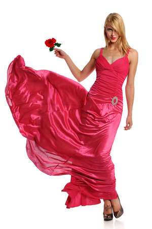 Portrait of beautiful young woman in pink evening gown holding rose 版權商用圖片 - 15261472