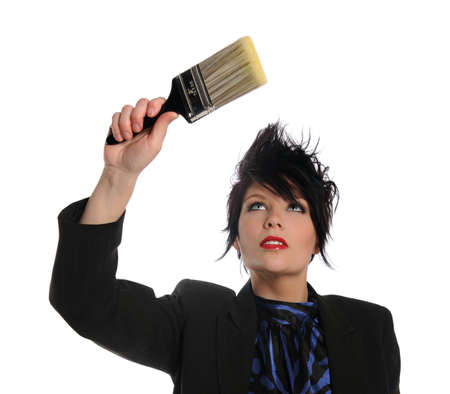 colo: Portrait of beautiful businesswoman with paintbrush isolated over white background Stock Photo