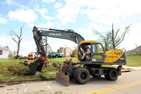 ravaged: SAINT LOUIS, MO - APRIL 22: Clean up after the destruction left behind by tornadoes that ravaged the area. April 22, 2011 in Saint Louis, Missouri  Editorial