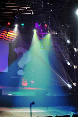 Stage lights with guitar and electronic equipment photo