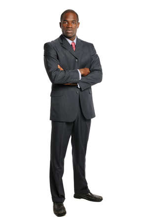 black suit: Portrait of African American businessman with arms crossed isolated over white background