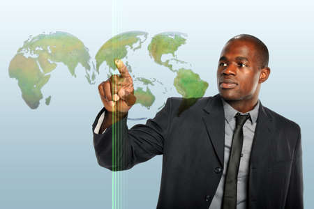 technology metaphor: African American businessman touching world map hologram Stock Photo