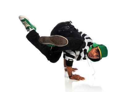 hand on hip: Portrait of African American hip hop dancer balancing on hands isolated over white background Stock Photo