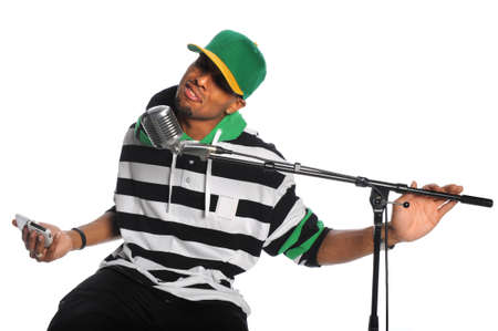 African American hip hop singer singing into vintage microphone isolated over white background photo