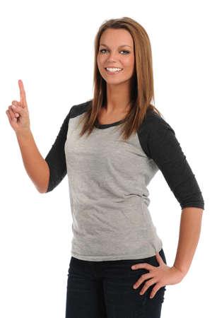 Retrato de mujer joven y bella señalando señalización o un número aislados sobre fondo blanco Foto de archivo - 15335047