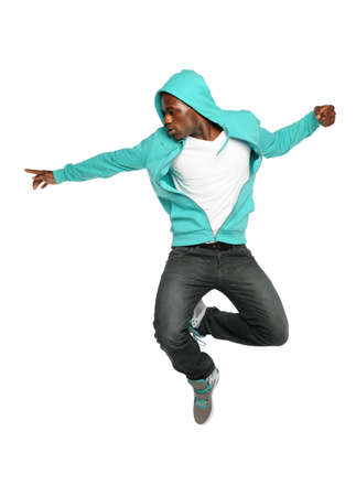 Portrait of African American hip hop dancer jumping isolated over white background photo