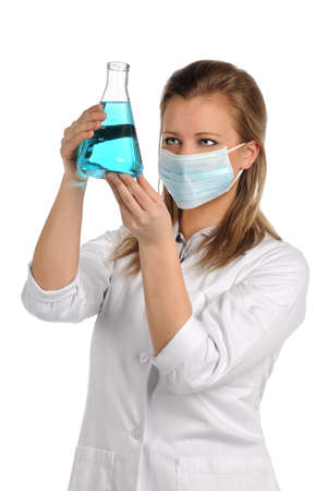 Female laboratory technician examining flask isolated over white background Stock Photo - 15398839