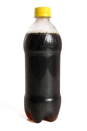 Dark soda in plastic bottle isolated over white background