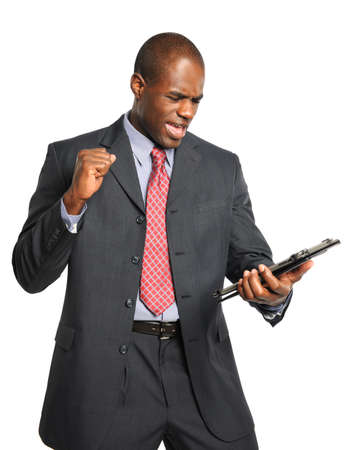 African American businessman celebrating after looking into electronic tablet Stock Photo - 15398876