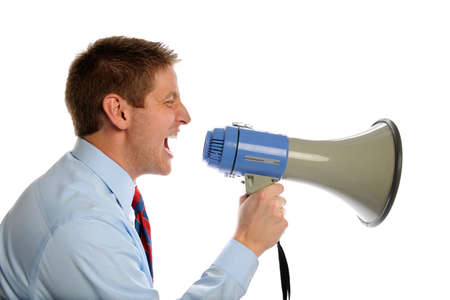 Young businessman using megaphone isolated over white background Imagens