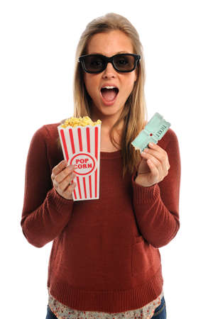 glass containers: Young woman watching movie with 3D glasses holding popcorn and tickets isolated over white background