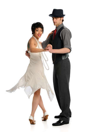 Couple dancing isolated over white background photo