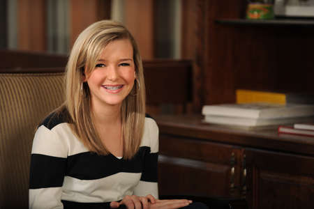 cute braces: Portrait of beautiful teen girl with braces smiling inside home