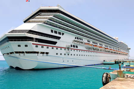 Passenger cruise ship at port in Caribbean waters photo