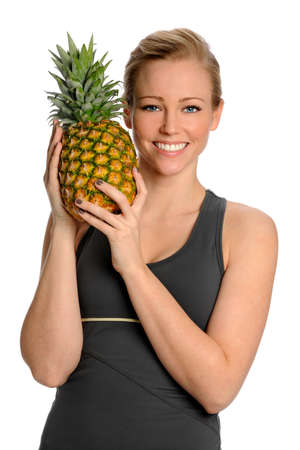 womna: Portrait of beautiful young womna holding pineapple isolated over white background