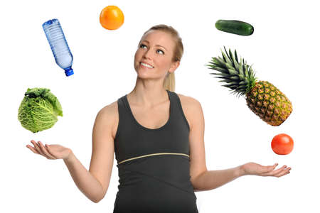 Beautiful young woman juggling fruits, vegetables and water isolated over white background