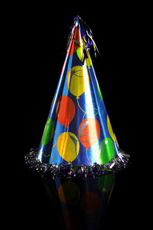shiny black: Shiny party hat isolated over black background with reflection