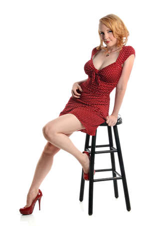 stool: Portrait of pin up girl in red dress isolated over white background