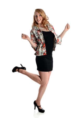 miniskirt: Beautiful woman expressing joy standing over white background