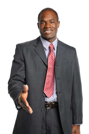 welcoming: African Amercian businessman offering handshake while smiling isolated over white background