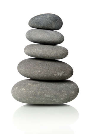Black stones stacked together isolated over white background