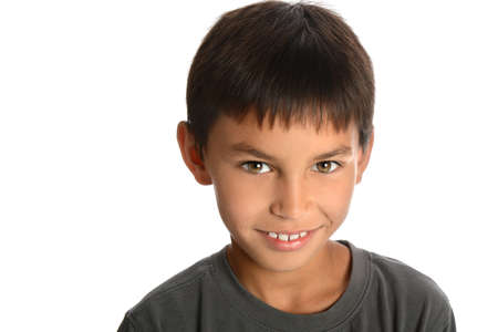 young boy smiling: Portrait of young boy smiling isolated over white background Stock Photo