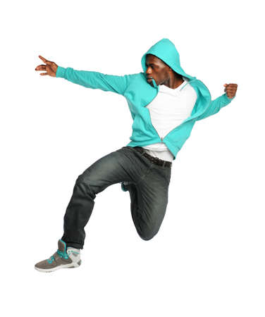 hip hop dancing: African American hip hop dancer jumping isolated over white background
