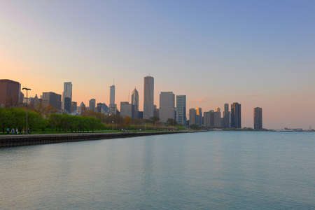 Downtown Chicago at dusk with Michigan lake in foreground photo