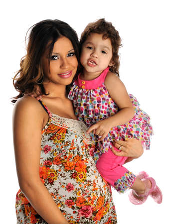 Portrait of Hispanic pregnant woman with daughter isolated over white background