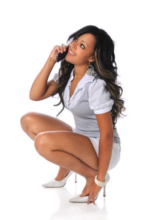 call: Beautiful African American woman using cellphone isolated over white background