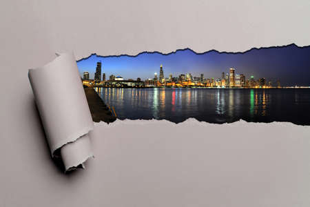 chicago skyline: Torn paper with Chicago skyline at dusk