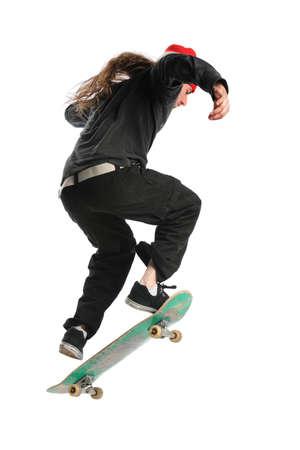 Skateboarder jumping isolated over white background photo