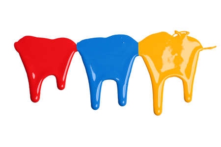Red, blue, and yellow paint dripping isolated over white background Stock Photo