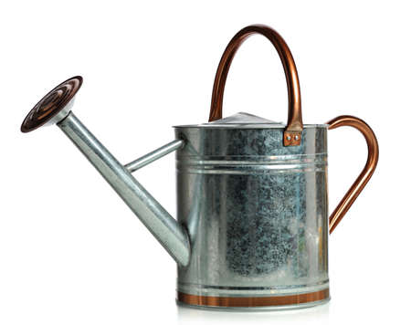 Metal watering can isolated over white background