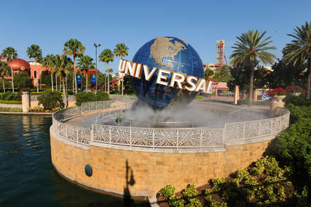 ORLANDO, FLORIDA - JUNE 04, 2012  Universal Studios theme park entrance with globe and sign