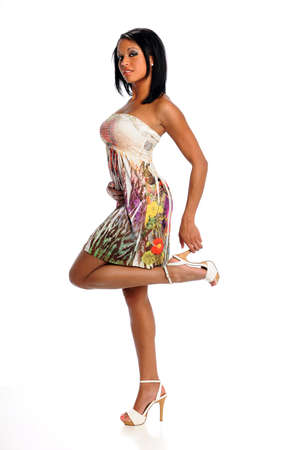 black heels: Portrait of beautiful African American woman standing isolated over white background Stock Photo