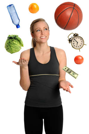 juggling: Young woman juggling healthy lifestyle isolated over white background Stock Photo