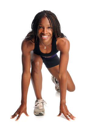 African American woman ready to run isolated over white background photo