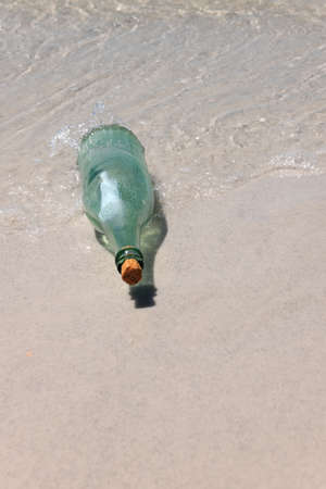Message in a bottle on sandy shore Stock Photo - 15673800