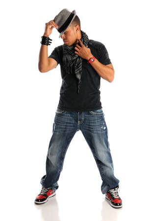 African American hip hop dancer tipping hat standing isolated over white background photo