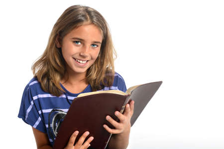 study: Portrait of young girl holding Bible isolated over white background