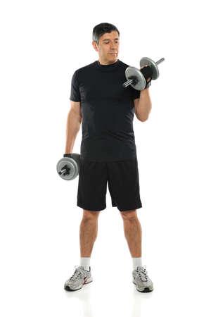latin man: Hispanic mature man using dumbbells standing over white background Stock Photo