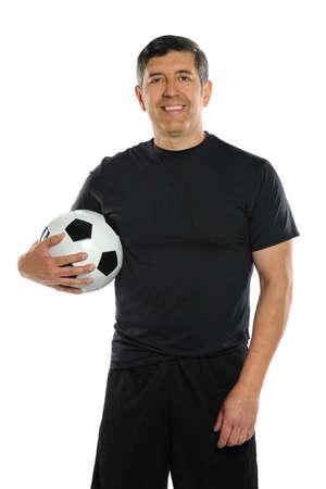 Mature Hispanic man holding soccer ball over white background photo