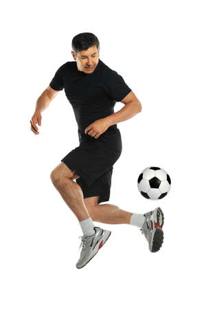 Hispanic man playing with soccer ball isolated over white background Foto de archivo