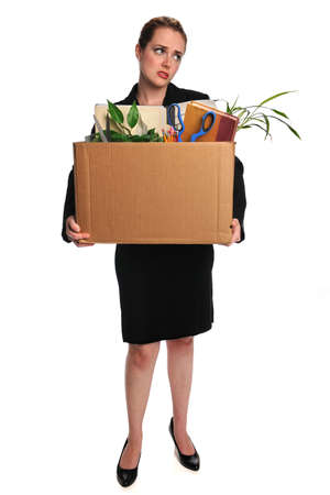 belongings: Young businesswoman carrying belongings after loosing employment