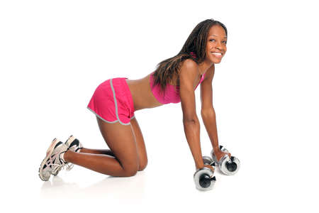 Young African American woman exercising with dumbbells on floor isolated over white background photo