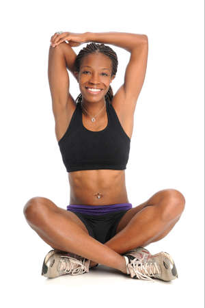 Young African American woman stretching isolated over white background photo