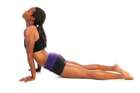 Young African American woman stretching on floor isolated over white background photo