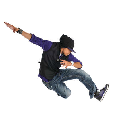 African American hip hop dancer jumping over white backgroun